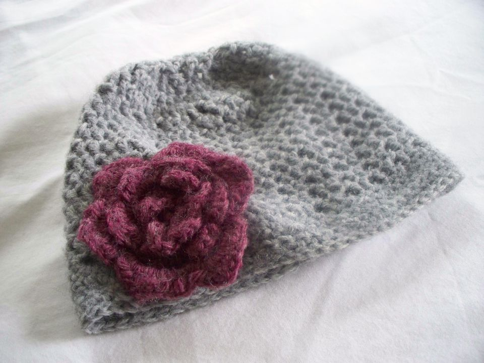 Crochet cap with flower