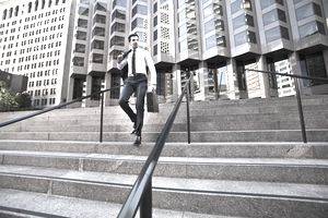 a businessman walking down steps by an office block