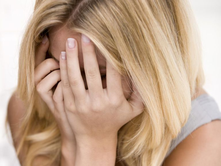 Woman Hiding Face
