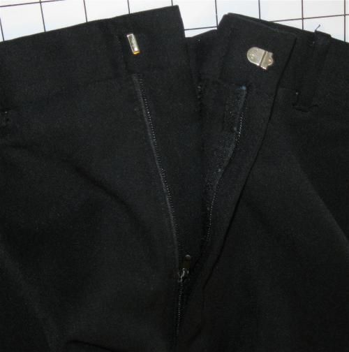 a trouser zipper and hook and eye