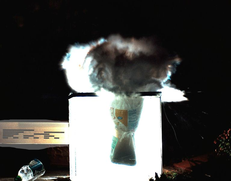 This is a high-speed photograph of a dry ice bomb exploding. Dry ice bombs can throw shrapnel and cause permanent hearing loss.