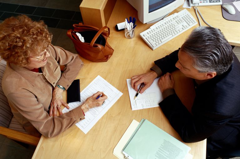 Financial Advisor Assisting Woman with Paperwork