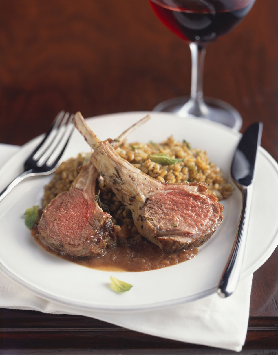 Rack of lamb with rice in plate, close up