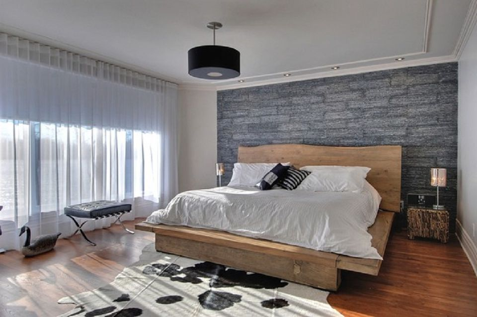 Modern rustic bedroom with stone wallpaper.