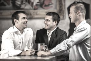 Businessmen in a bar