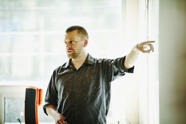 man speaking in office