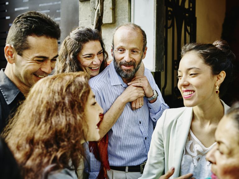 Family talking and laughing during party