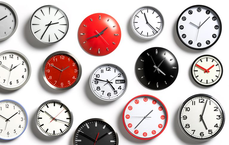 Photo of clocks of different colors and various times