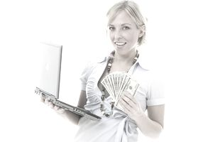 Image of a woman holding a laptop and money.