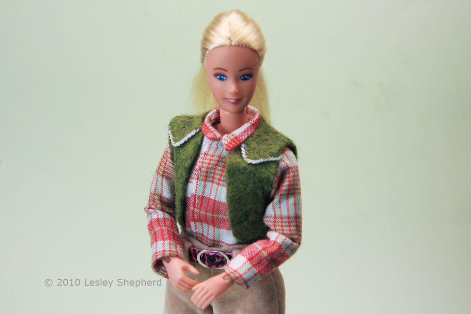 Basic front opening doll's shirt with sleeves is shown worn under a simple vest.