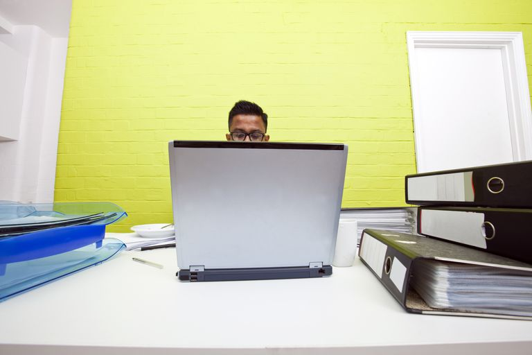 man working at laptop