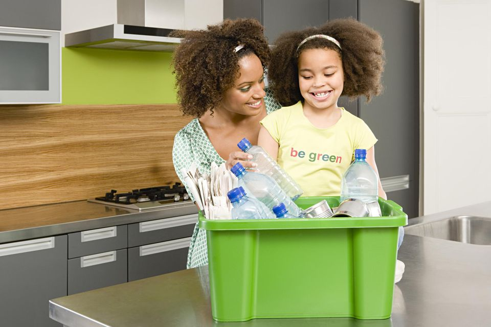 Mother and daughter recycling.