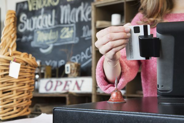 Credit card being swiped in small business