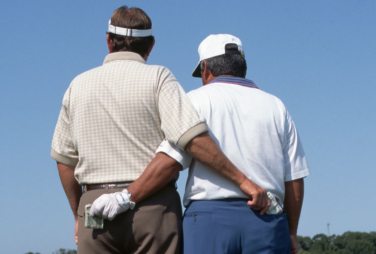 Ray Floyd and Lee Trevino pretend to pick each other's pockets