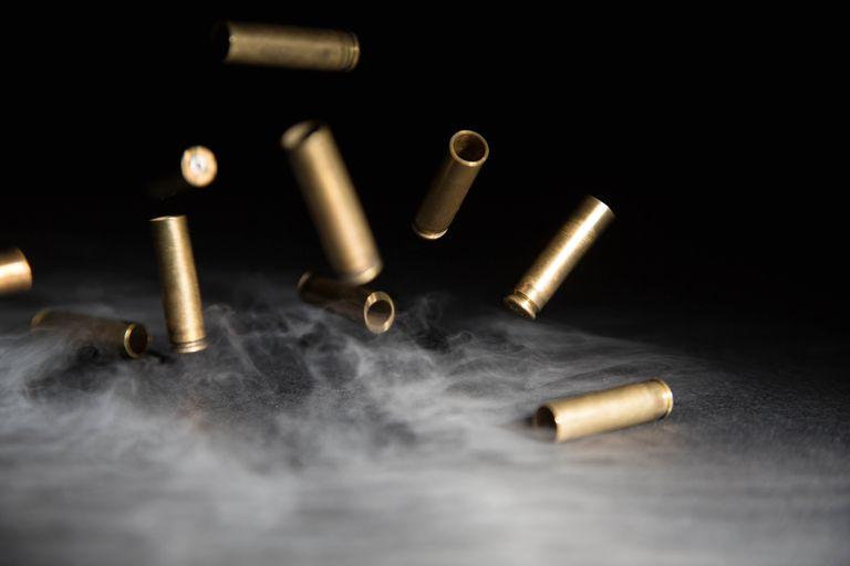 Smoking Bullets Falling on Ground