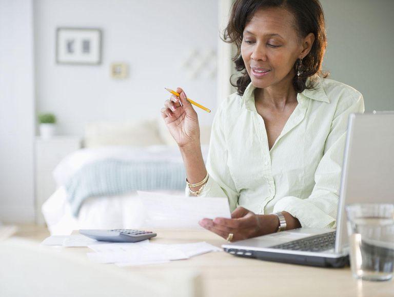 Black woman paying bills