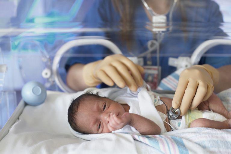 Physician examining newborn