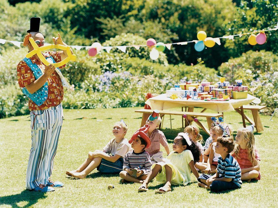 Clown making balloon animals at party