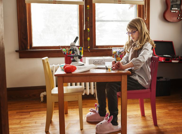 Young girl working on science project