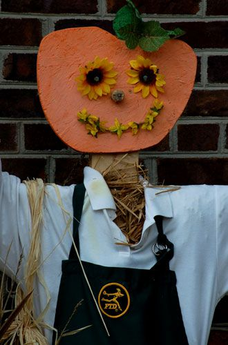 Scarecrow in photo bears FTD label. Halloween scarecrow picture was taken in 'Bedford Falls.'