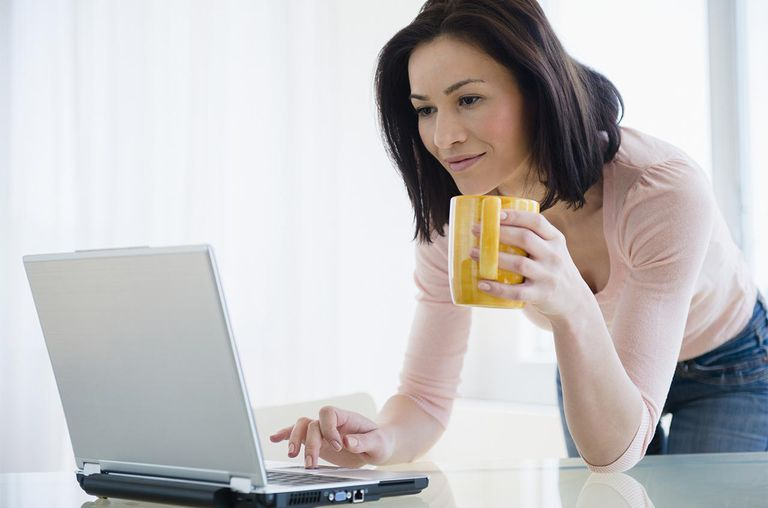 Caucasian woman using laptop