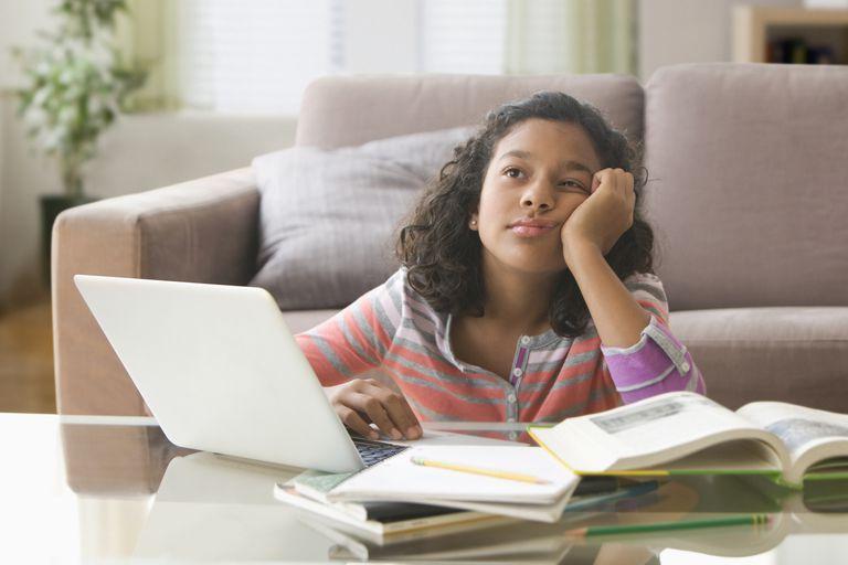 Bored girl doing schoolwork