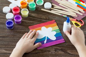 The child glues the detail. Present for St. Patrick's Day clover on a rainbow