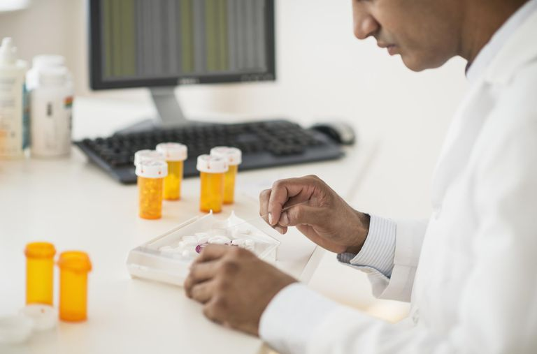 pharmacist preparing prescription pills
