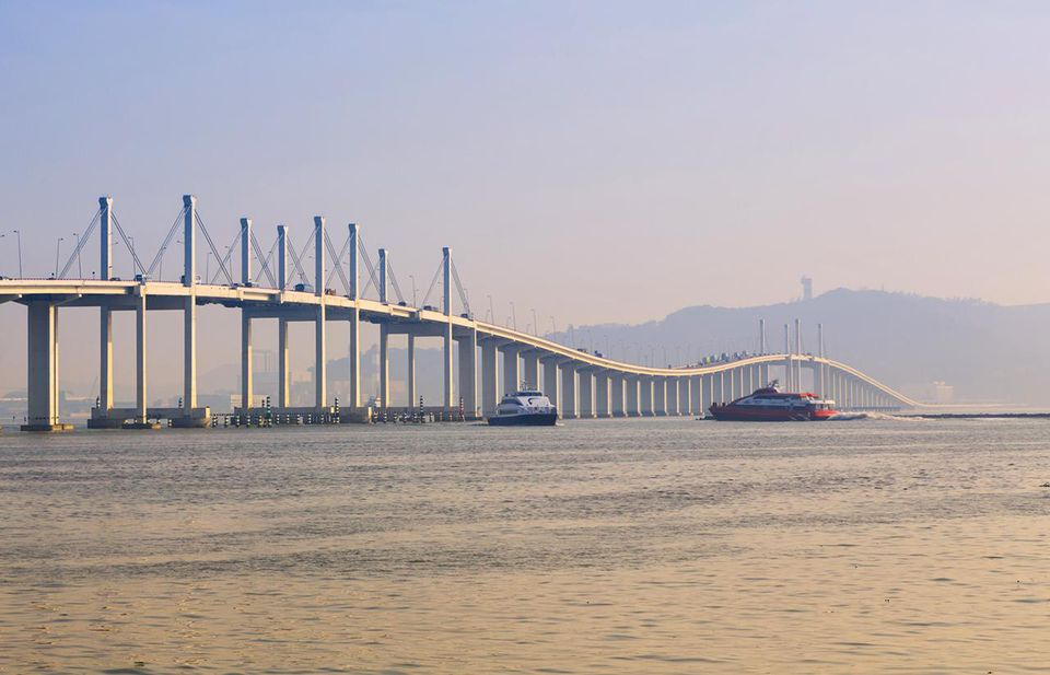Macau, China. Ferries at the Ponte de Amizade or Bridge of Friendship.