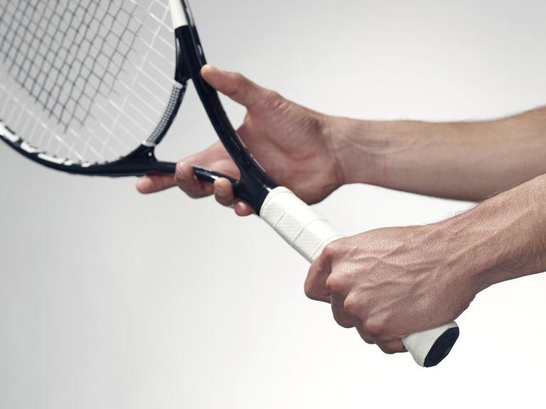 Hands holding a tennis racket