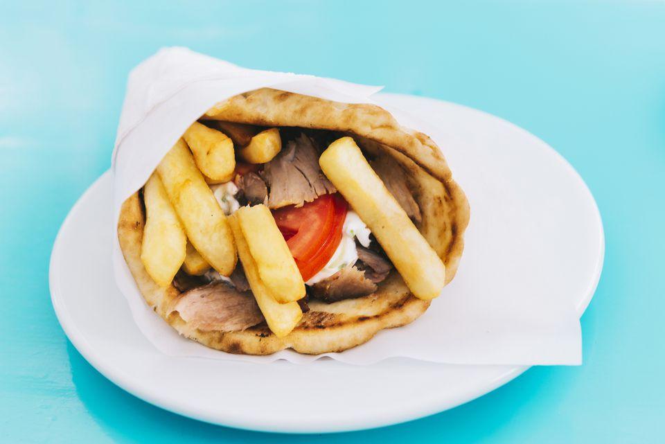 Greece, Pita bread with chicken Souvlaki, French fries and Tzatziki