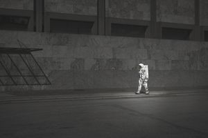 Astronaut in large room