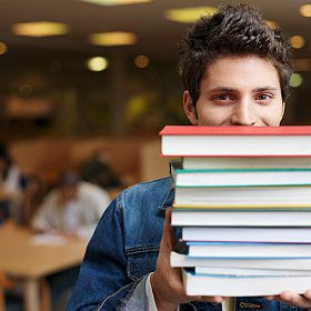 Young man with books