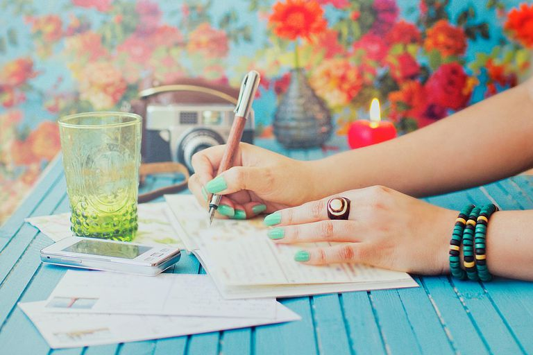 Girl writing homework notes in her planner