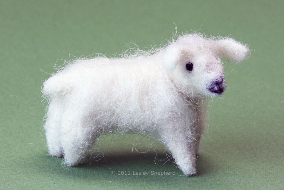 A felted miniature sheep in