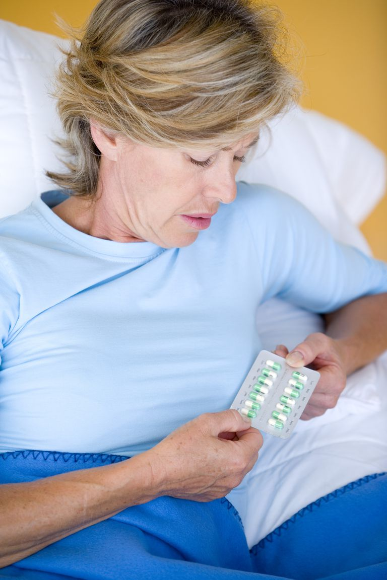 Woman in Bed With Antidepressants