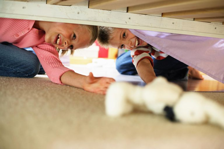 rainy day activities - kids reaching for stuffed animal under bed