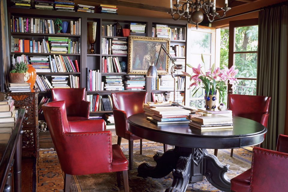 cozy home library furnished with antique and vintage finds