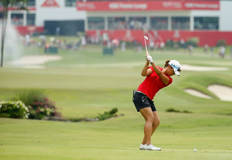 Lydia Ko plays an approach shot into the green during the LPGA's HSBC Women's Champions tournament in 2015