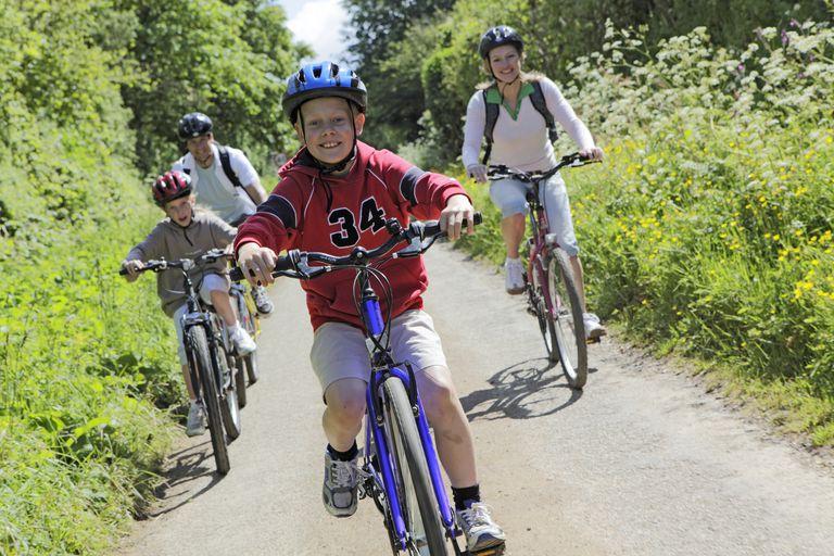 A family riding their bikes.