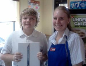 Photo of 13-year-old Alexander Clark winning a free iPad.