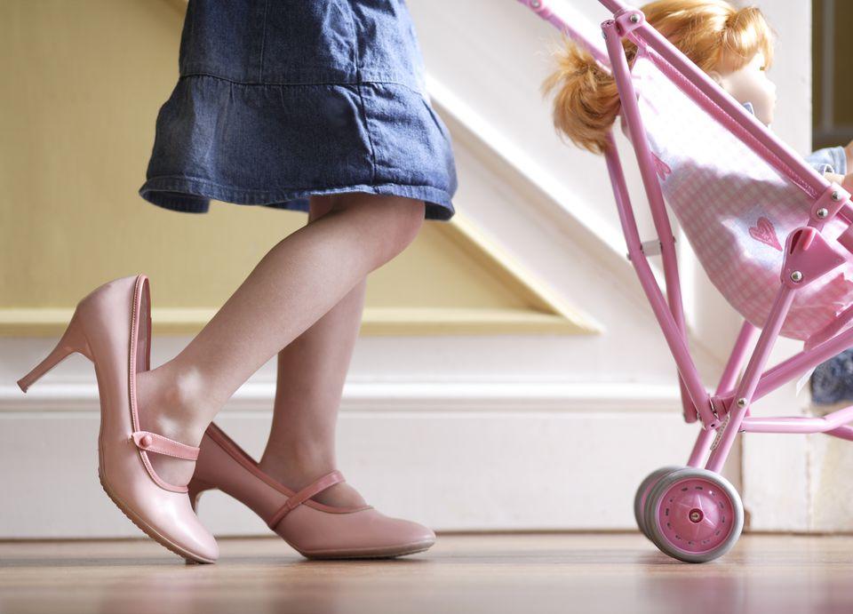 Little Girl Pushing Stroller