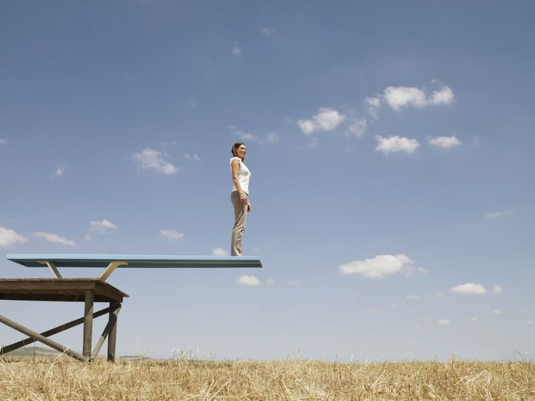 Woman on edge of diving board - launching author platform