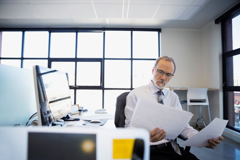 Architect reviewing plans in office