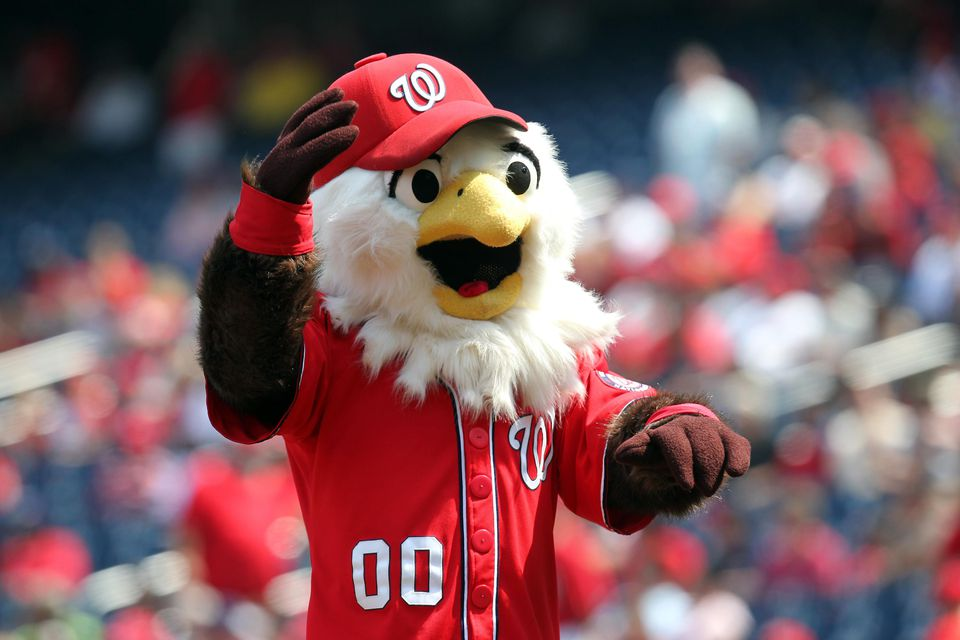 Mascot Screech of the Washington Nationals encourages the crowd against the Miami Marlins at Nationals Park on September 8, 2012 in Washington, DC. The Nationals won 7-6.
