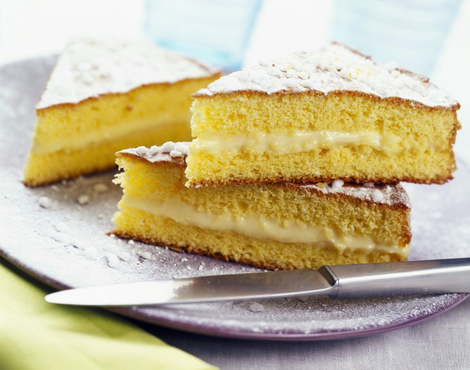 3 slices of yellow cake with creamy filling on a purple plate