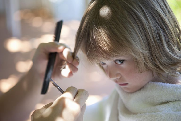 A picture of a child getting a haircut