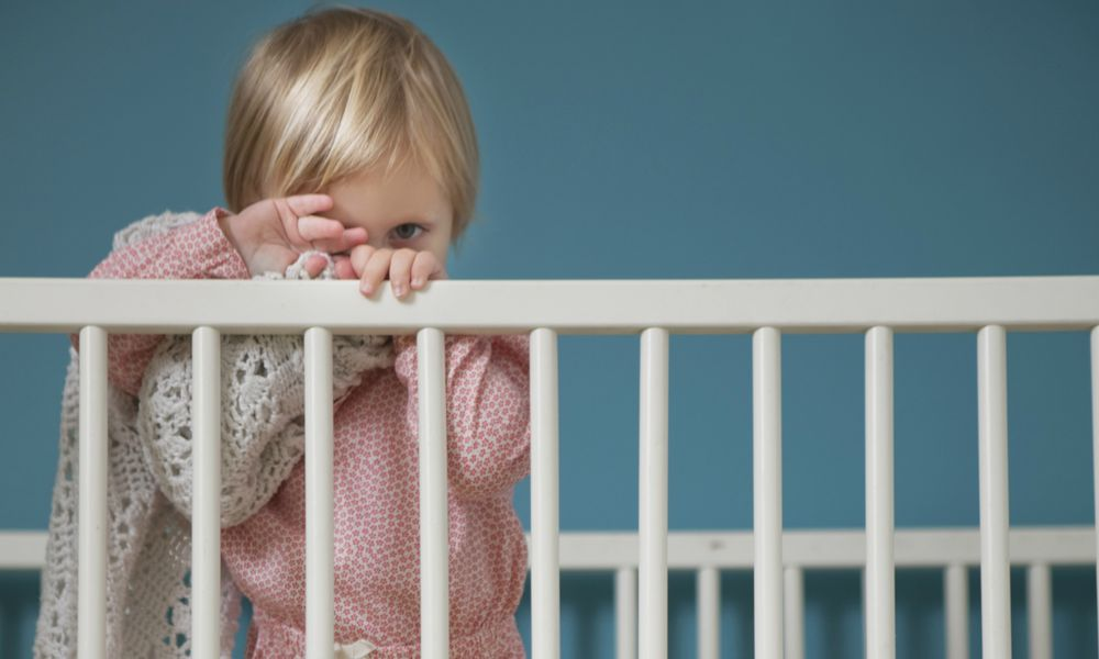 Portrait of female toddler hiding behind comfort blanket in crib : Stock Photo CompEmbedShareADD TO BOARD Portrait of female toddler hiding behind comfort blanket in crib