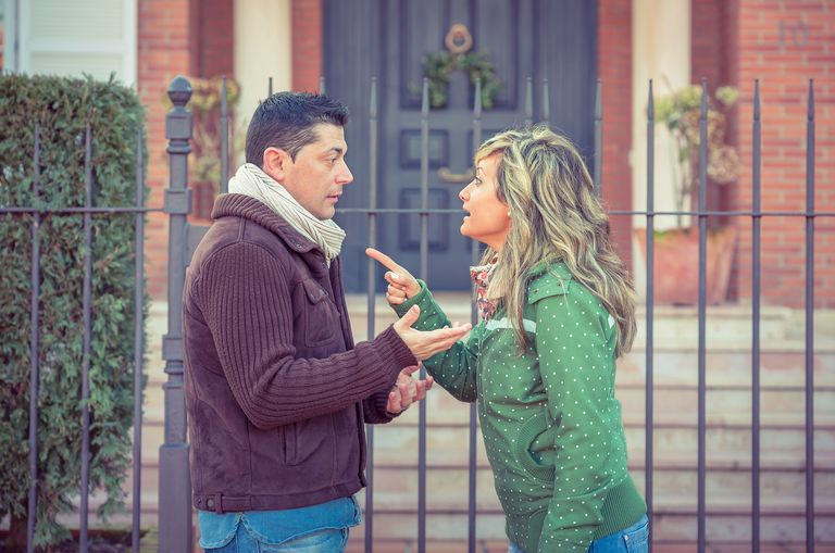 man and woman arguing in the street