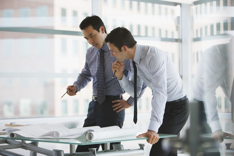 Businessmen working together in office
